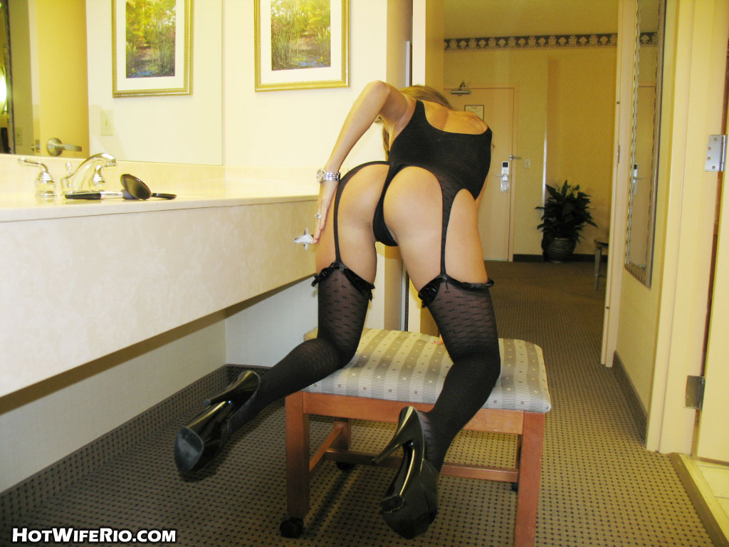 Latina housewife releases her big tits from black lingerie in matching hosiery