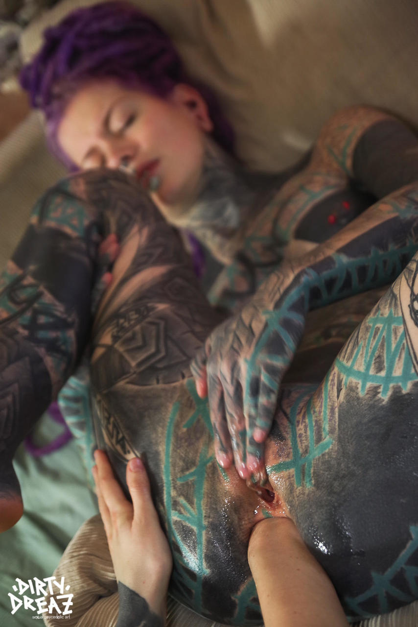 Heavily tattooed girl has her gaped anus fisted by her lover