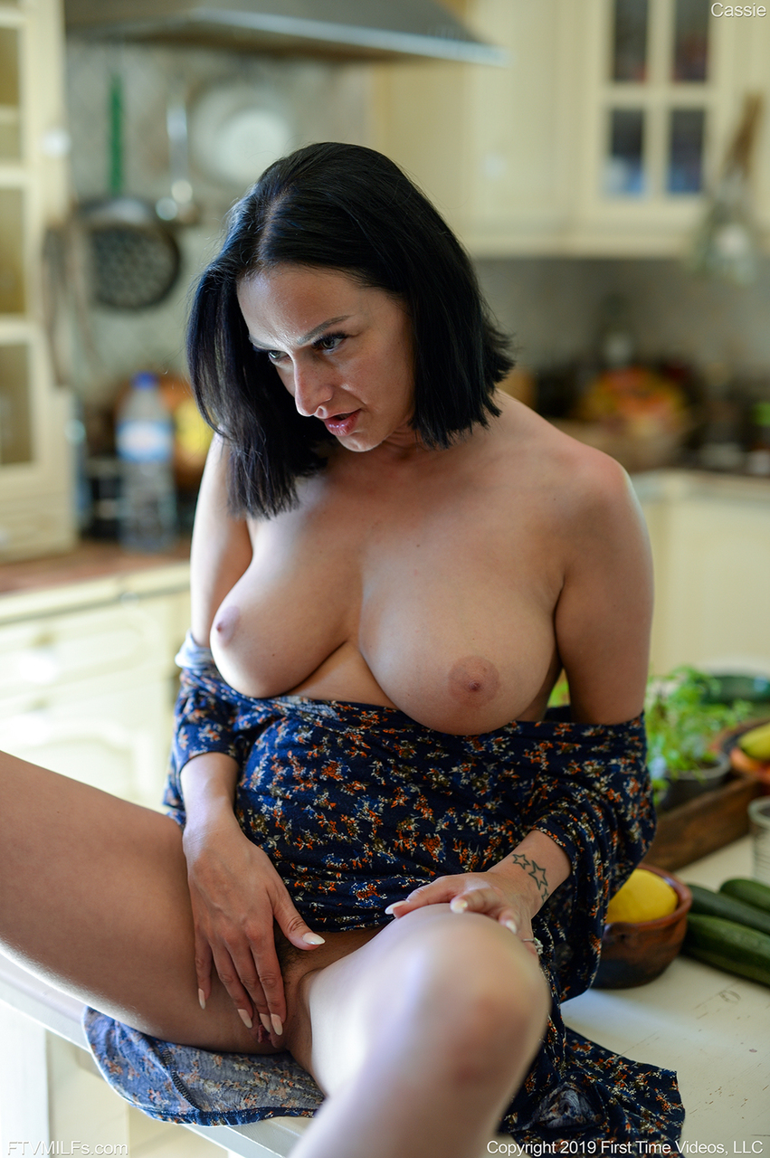 Busty chick has her trimmed pussy stuffed with an English cucumber