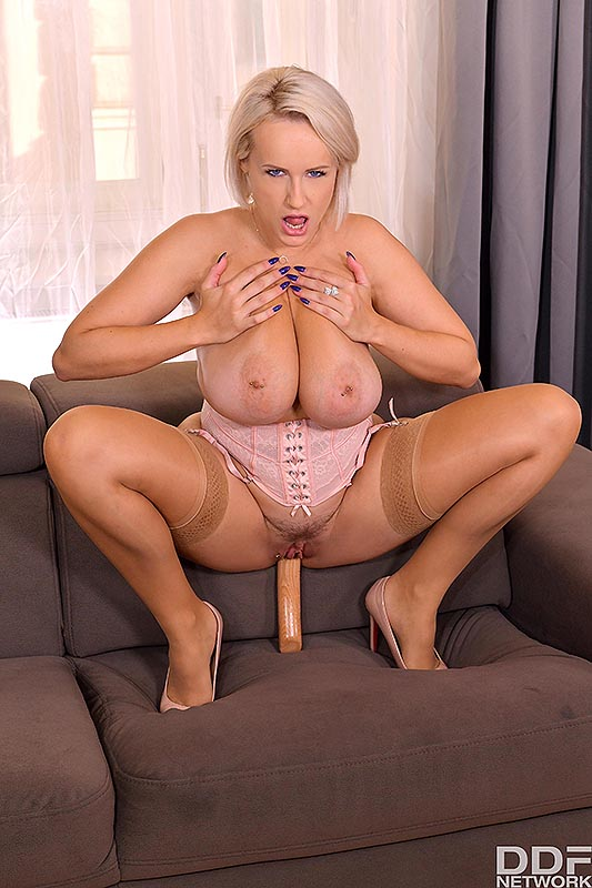 Big titted blonde Angel Wicky toys her trimmed muff with a wooden dildo