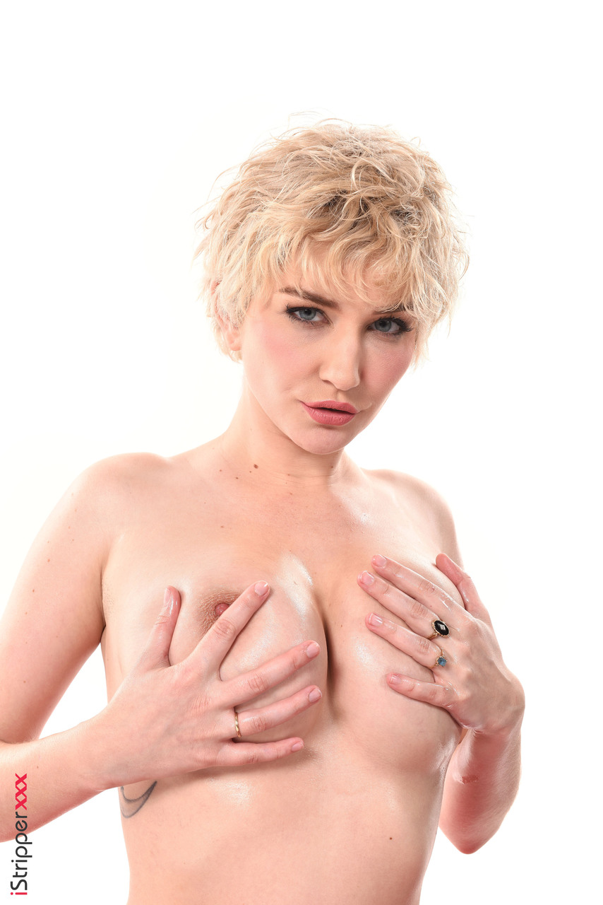 Short haired blonde Skye Blue covers nice tits in lotion before masturbating