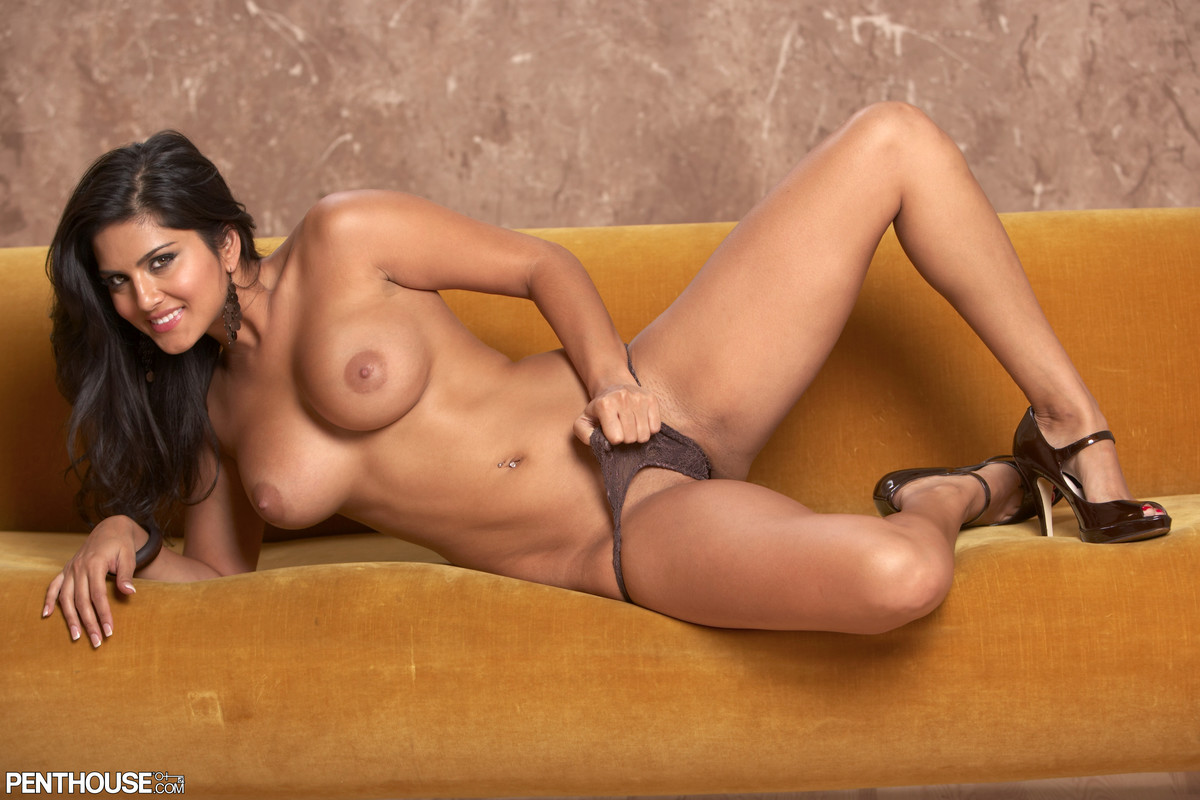Sexy brunette Sunny Leone strips to ankle strap heels for a centerfold spread