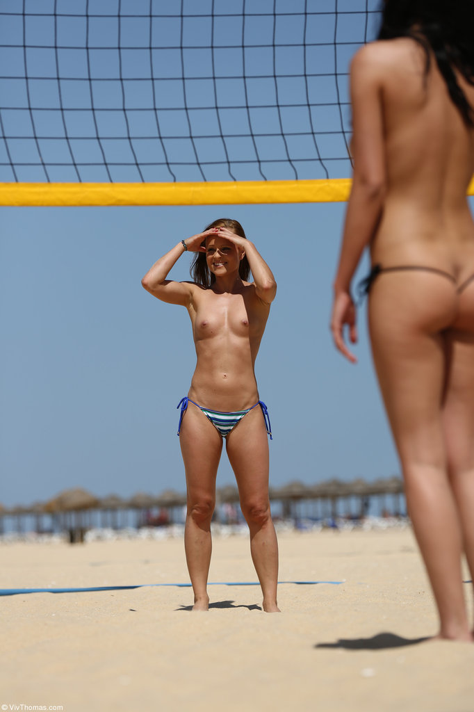 College girls go topless during a game of beach volleyball