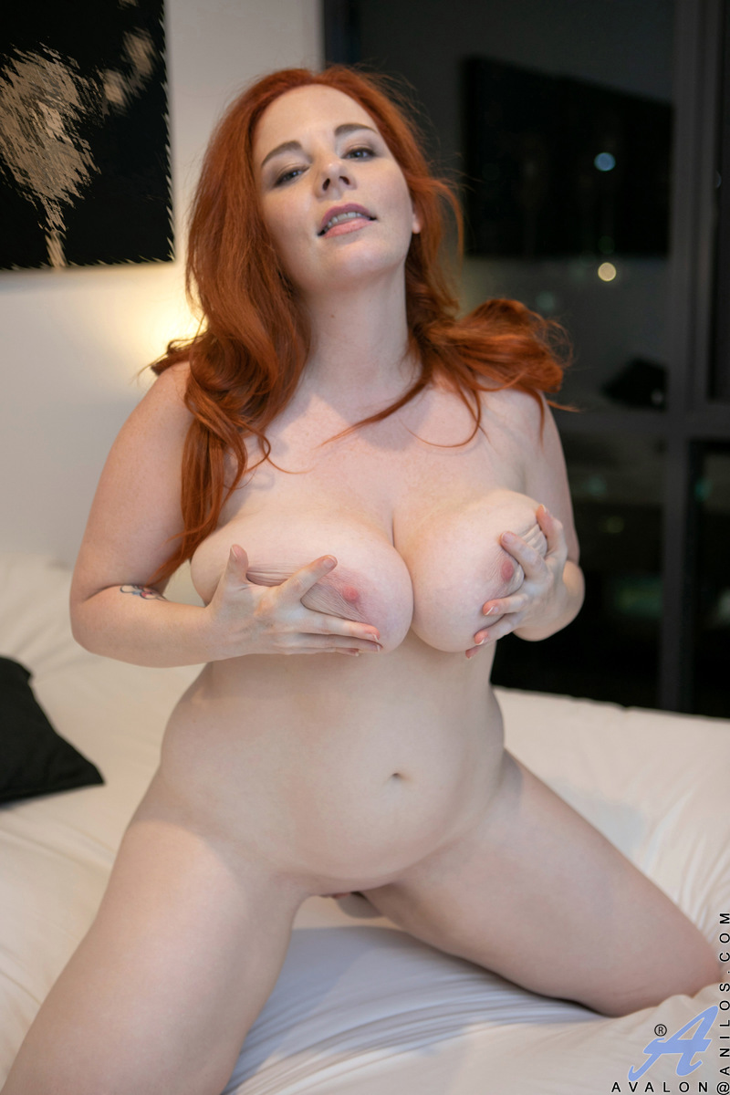 Natural redhead plumper Avalon uncovers huge tits before showing her fat ass