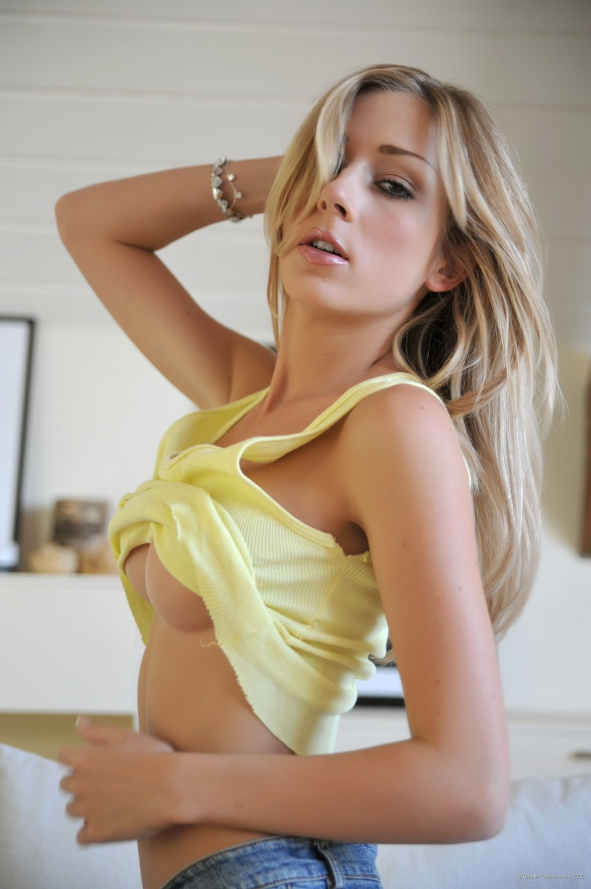 Dirty blonde completely exposes her upskirt panties before showing her boobs
