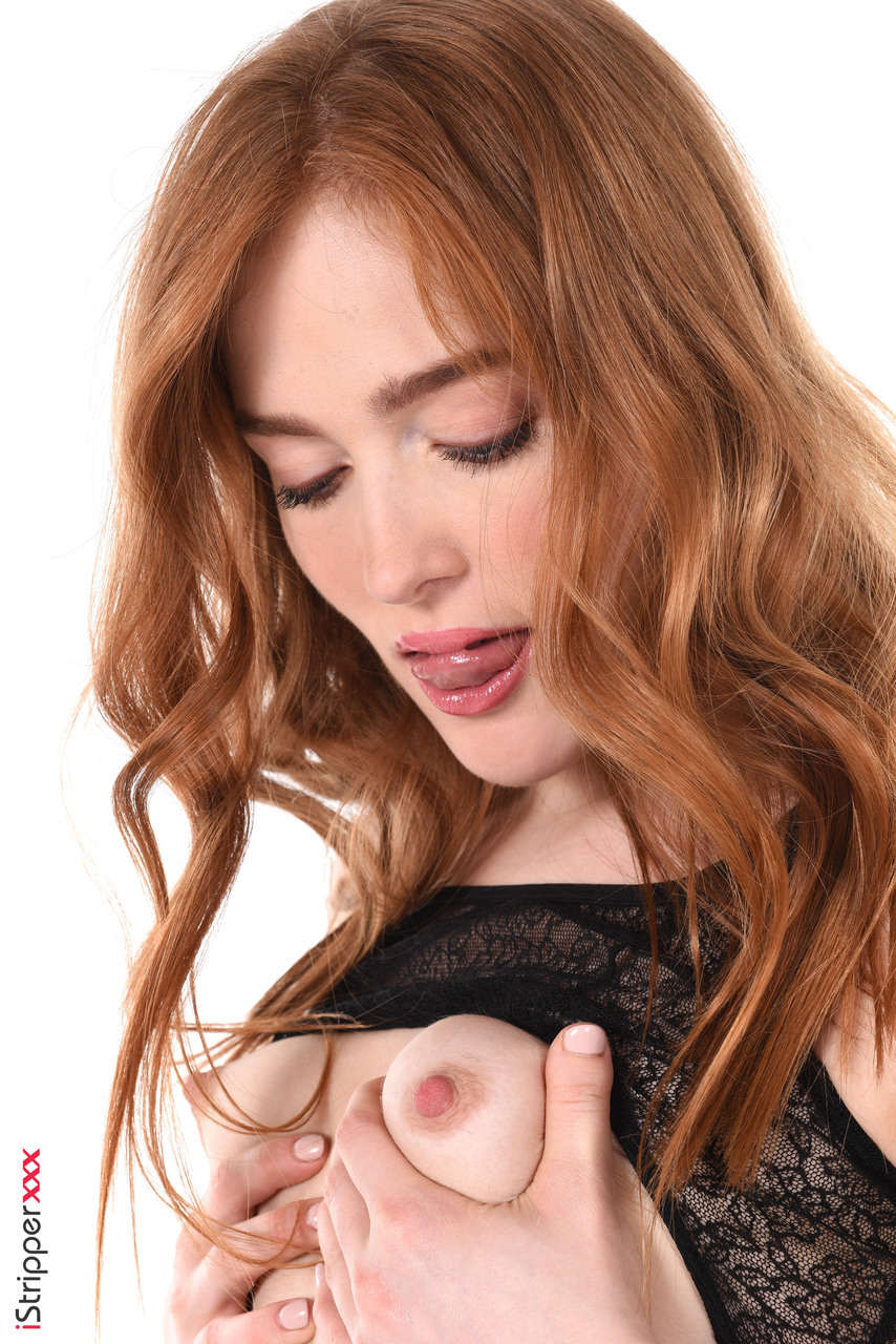 Beautiful redhead Jia Lissa fingers her landing strip pussy in OTK nylons