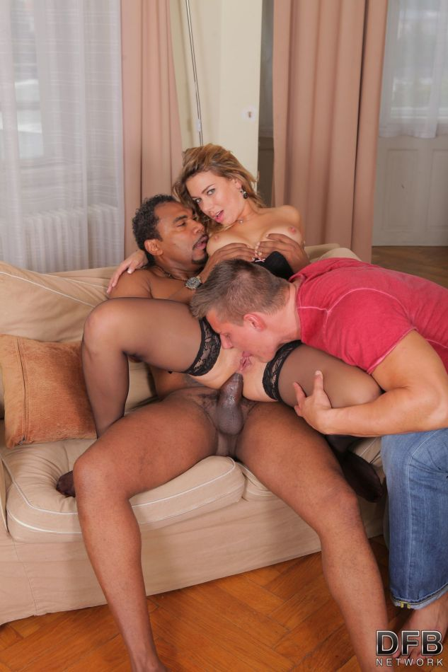 Blond wife gets banged by a big black dick while her husband licks her pussy