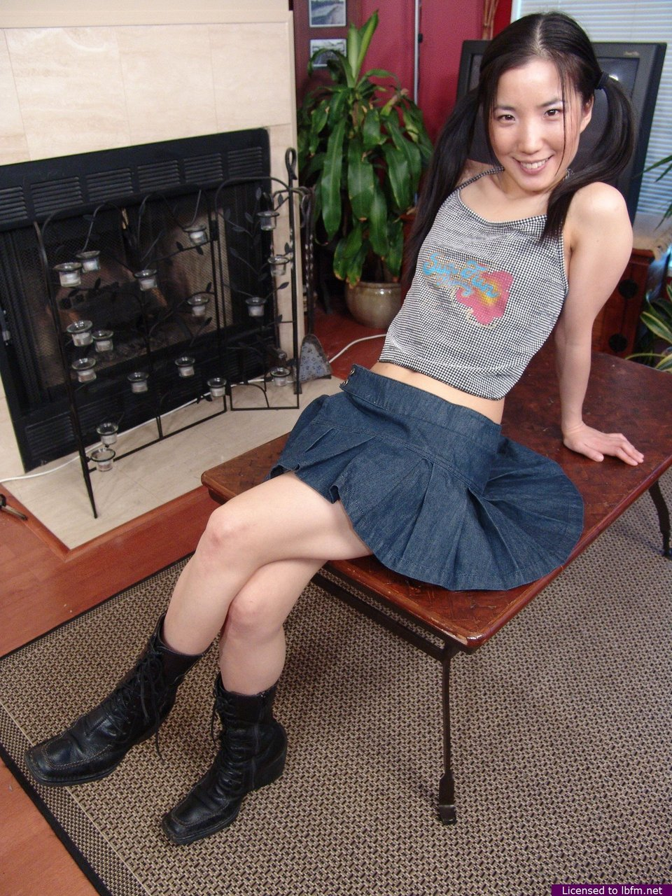 Young Asian girl Almond plays with her pussy in black boots and pigtails