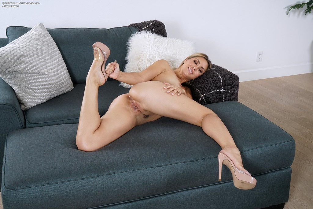 Long-legged blonde Alina Lopez does the splits before toying her wet vagina